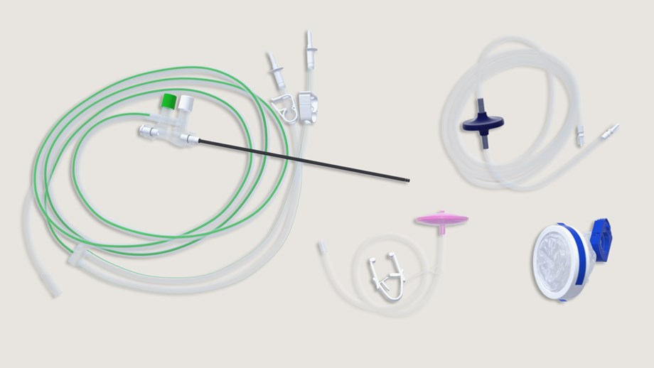 collection of laparoscopic tray components: camera cover, insufflation tube, smoke filter