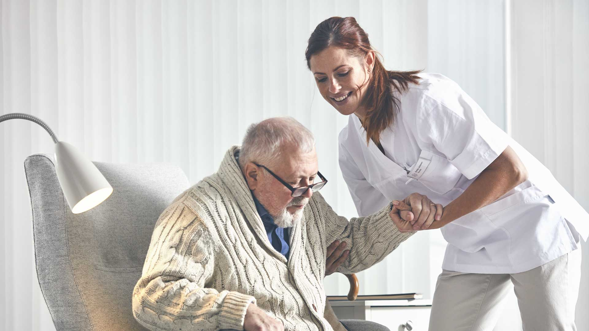 Home Care nurse tending to an elderly patient